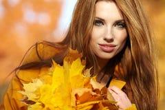 Woman portrait in autumn color Stock Photos
