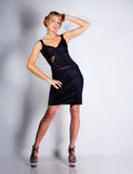 Woman portrait in black dress Stock Images