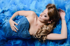 Woman portrait in blue dress Stock Images