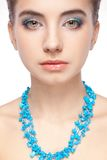 Woman portrait with blue necklace Royalty Free Stock Photo
