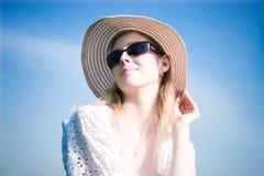Woman portrait on blue sky background Stock Image