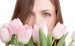 Woman portrait with bouquet of tulips Stock Image