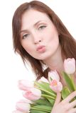 Woman portrait with bouquet of tulips Stock Images