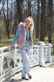Woman portrait in bright clothes in spring park, still while without foliage Royalty Free Stock Photo