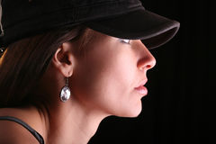 Woman portrait in cap Royalty Free Stock Photography