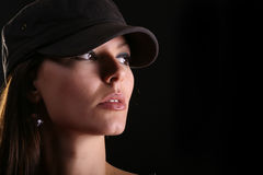 Woman portrait in cap Royalty Free Stock Images