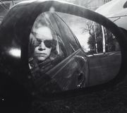 Woman portrait in car mirror Royalty Free Stock Image