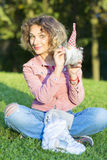 Woman portrait is with the Christmas toy. Stock Photography