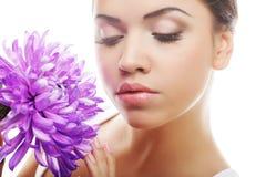 woman portrait with chrysanthemum. Spa treatment. Stock Image