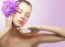 Woman portrait with chrysanthemum. Spa treatment. Royalty Free Stock Image