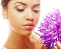 Woman portrait with chrysanthemum. Spa treatment. Royalty Free Stock Images
