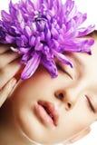 Woman portrait with chrysanthemum. Spa treatment. Royalty Free Stock Photo