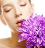 Woman portrait with chrysanthemum. Spa treatment. Royalty Free Stock Photos