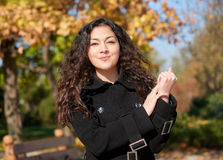 Woman portrait in city park in fall season Royalty Free Stock Photo
