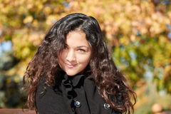 Woman portrait in city park in fall season Stock Images