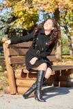 Woman portrait in city park in fall season Stock Photo