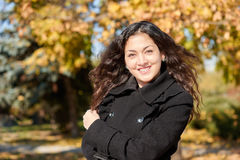 Woman portrait in city park in fall season Stock Photos