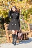 Woman portrait in city park in fall season Stock Image