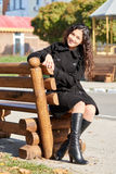 Woman portrait in city park in fall season Royalty Free Stock Images
