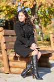 Woman portrait in city park in fall season Stock Photography