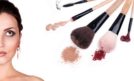 Woman portrait with cosmetics and makeup brushes Stock Image
