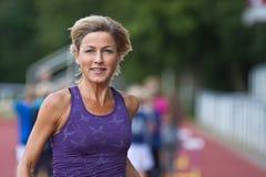 Woman portrait doing sport Stock Images