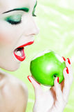 Woman portrait eat an apple Royalty Free Stock Image