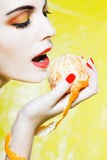 Woman Portrait eating a mandarin orange tangerine Royalty Free Stock Images