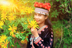 Woman portrait with flower. Woman portrait wear hill tribe costume with yellow flower Stock Photography