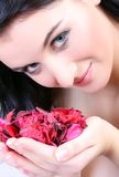 Woman portrait with flowers Stock Images