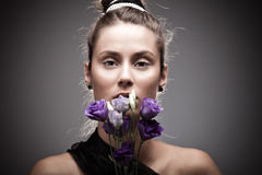 Woman portrait with flowers Stock Image