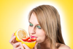 Woman portrait with fresh lemon and strawberry. Royalty Free Stock Photos
