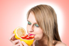 Woman portrait with fresh lemon and strawberry. Stock Photo