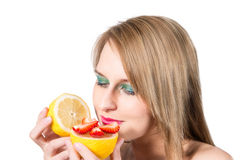 Woman portrait with fresh lemon and strawberry. Stock Photos