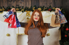 woman portrait  with gift packages Christmas. Christmas red girl near christmas tree winter fairy tale Royalty Free Stock Photos