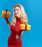 Woman portrait with gifts boxes smiling. Christmas Stock Images