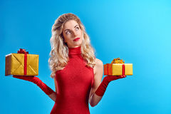 Woman portrait with gifts boxes smiling. Christmas Stock Photo