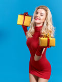 Woman portrait with gifts boxes smiling. Christmas Stock Image