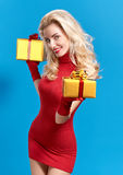 Woman portrait with gifts boxes smiling. Christmas Stock Photos