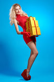 Woman portrait with gifts boxes smiling. Christmas Royalty Free Stock Images