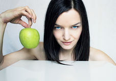 Woman Portrait with Green Apple Royalty Free Stock Photos