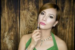 Woman Portrait with green dress Stock Photography