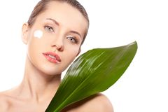 Woman portrait with green leaf Stock Images