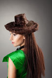 Woman portrait in hair style like hat on grey Stock Photography