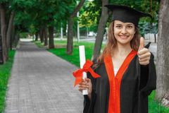 Woman portrait on her graduation day. University. Education, graduation and people concept.  royalty free stock image