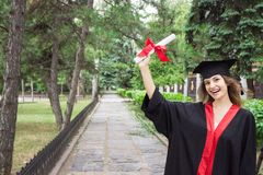 Woman portrait on her graduation day. University. Education, graduation and people concept.  stock image
