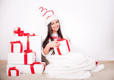 Woman portrait hold christmas gift Royalty Free Stock Images