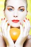 Woman portrait holding a orange citrus fruit Stock Photography
