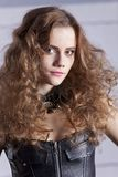 Woman portrait in leather corsage royalty free stock image