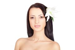 Woman portrait with lily in her hair Royalty Free Stock Images
